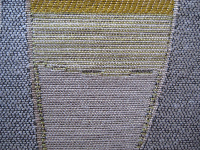 Trouble-shooting: this sample shows an identified flaw (black lines), which needed to be removed from the final textile.