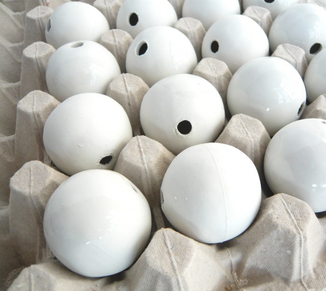 the porcelain beads, partly glazed