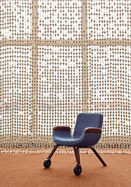 A UN Lounge Chair in front of the curtain  © Frank Oudeman