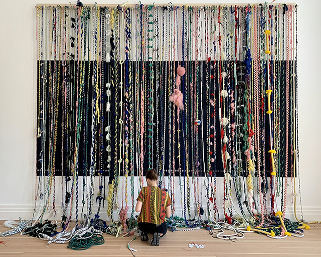 The Cosmic Loom at the end of the exhibition, with one yarn spun every day.