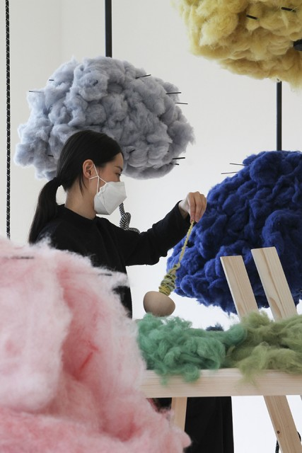 Clouds of recycled fibres were used to spin the warp of the Cosmic Loom during the exhibition Woven Cosmos