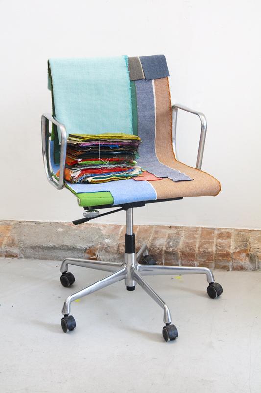 Textile samples on the Eames Alu Chair
