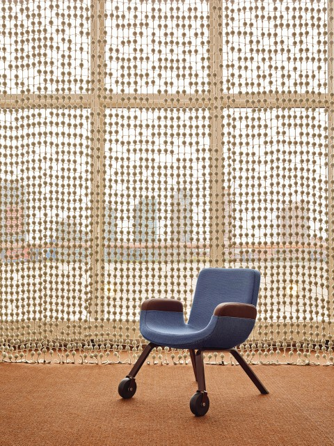 UN Lounge Chair in fron of the Knots & Beads Curtain at the UN North Delegates' Lounge